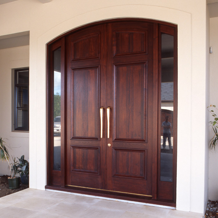 Large feature double wooden doors with side lights